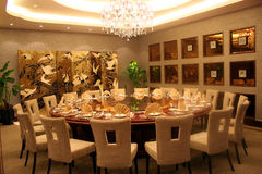 Round banquet table. With chairs by door Stock Photography