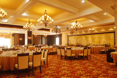 Round banquet table. With chairs by door Stock Photo