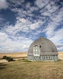 Round barn against a blue sky. Royalty Free Stock Photo