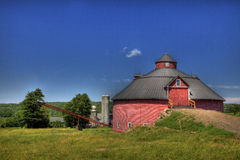 Round Barn in Farm Country. A round barn sits in farm country Stock Photo