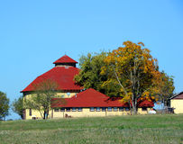 Round Barn with Shingle Roof Stock Photo