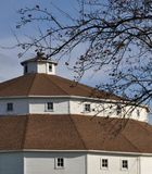 Round Barn - White with red roof - bright blue sky Stock Photos