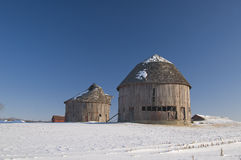 Round barns in wintertime Stock Photo