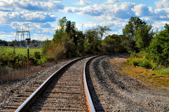 Round the bend. Image of train tracks in the country Royalty Free Stock Images