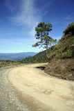 Round the bend mountain road. Halsema mountain highway running between baguio and bontoc in the central cordillera, the philippines royalty free stock photography