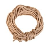 Round bight of natural jute rope isolated on white. Background stock photography