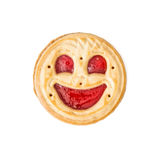 Round biscuit smiling face on the white background, humorous swe Stock Photography