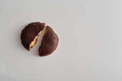 Round biscuits covered in chocolate broken in half Stock Images