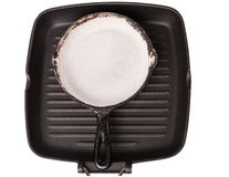Black cast-iron pan for frying Stock Images