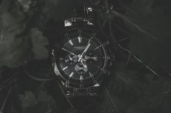 Round Black Current Chronograph Watch With Link Bracelet royalty free stock images
