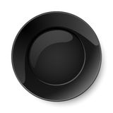 Round black plate Stock Images