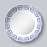 Round blue floral frame. Styling elements based on Chinese or Russian porcelain painting. Ornament shown in a ceramic dish. Round blue floral frame. Styling Royalty Free Stock Images