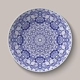 Round blue floral ornament Chinese style painting on porcelain. Pattern shown on the ceramic platter. Royalty Free Stock Images