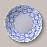 Round blue floral ornament ethnic style. Pattern shown on the ceramic plate. Royalty Free Stock Images
