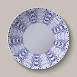 Round blue floral ornament oriental style. Pattern shown on the ceramic platter. Stock Photography