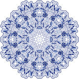 Round blue lace doily mandala with swirls, flowers and foliage. Styling oriental motifs. Royalty Free Stock Photo