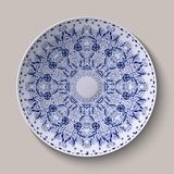 Round blue lacy delicate floral pattern. Stylized Chinese style painting on porcelain. Stock Photo