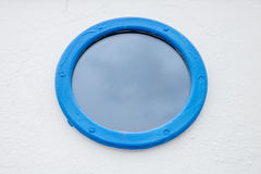Round blue painted window Stock Photography
