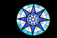 Round Blue and White Stained Glass Window. A round blue and white stained glass window on black background Royalty Free Stock Photo