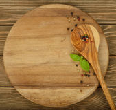 Round board and wooden spoon Stock Images