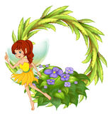 A round border with a fairy in her yellow dress Stock Photos