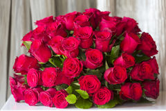 A round bouquet of red roses. Close up on a round bouquet of red roses Stock Photography