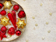 Round box with red and gold Christmas decorations. New Year and Xmas card background. Copy space. Selective focus. Royalty Free Stock Image