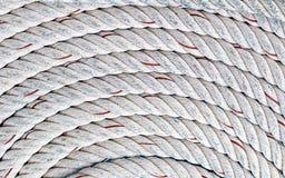 Round braided white rope background marine design base hard natural fiber boat fix yacht symmetrical pattern royalty free stock photo
