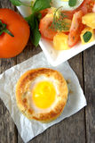 Round bread bun with egg inside bun Royalty Free Stock Images