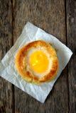 Round bread bun with egg inside bun Stock Photo