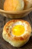 Round bread bun with egg inside bun Stock Image