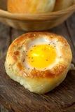 Round bread bun with egg inside bun Royalty Free Stock Photo