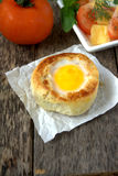 Round bread bun with egg inside bun Stock Photos