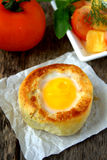 Round bread bun with egg inside bun Stock Images