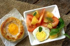 Round bread bun with egg inside bun Royalty Free Stock Photos