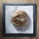 Round bread loaf on Black Slate Board. Stock Photography