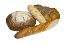 Round bread, plaited bread  and two baguettes. Stock Photos