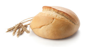 Round bread and wheat Royalty Free Stock Image