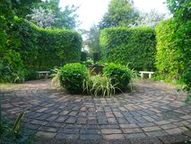 Round brick path in English garden Royalty Free Stock Photography