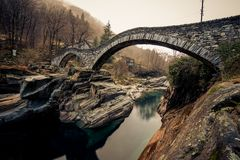 The round bridges of ticino italy. This image features the round bridges of ticino Italy in the autumn stock photography