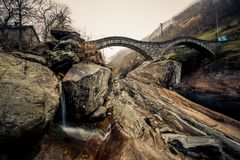 The round bridges of ticino italy. This image features the round bridges of ticino Italy in the autumn stock image