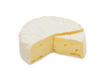 Round Brie cheese, isolated Stock Photo