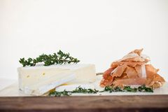 A round of brie and prosciutto royalty free stock photography