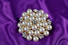 Round brooch with pearls Stock Photos