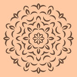 Round brown flower pattern on beige background Royalty Free Stock Photo