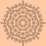 Round brown ornate pattern on beige background Royalty Free Stock Photography