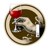 Round brown retro label with ribbon and man`s hand holding a gla Royalty Free Stock Photo