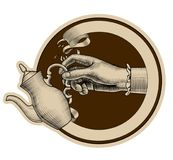 Round brown retro label with ribbon and woman`s hand holding a c Royalty Free Stock Image