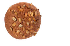 Round a bun with pumpkin seeds isolated on a white background Stock Photography