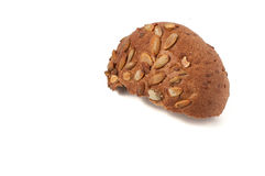 Round a bun with pumpkin seeds wherein is isolated on a white background Royalty Free Stock Photos